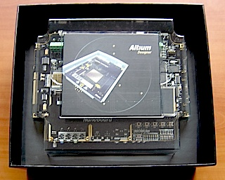Opening the box reveals the board software the black pcb with gold